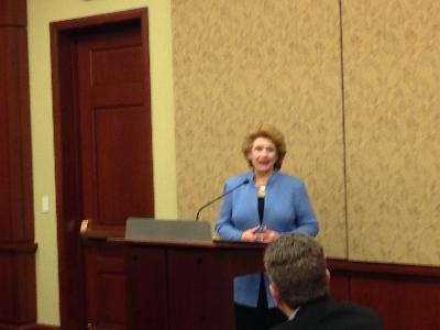 Sen. Debbie Stabenow stands at the podium at the CUNA GAC