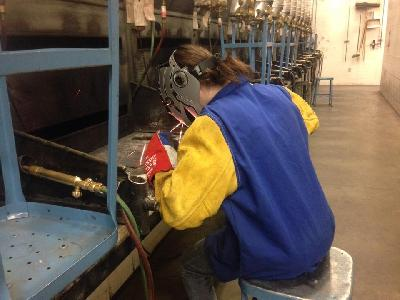 LCC student Sara Evans, 17, practices welding during lab time