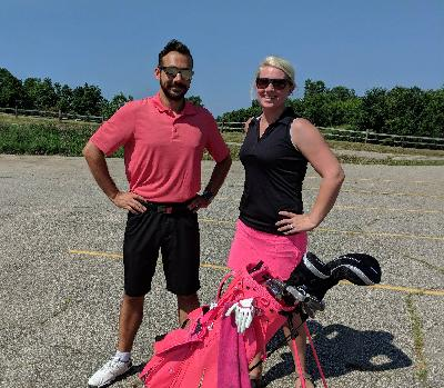 MCUL staff members Kevin and Haleigh preparing for the 2018 ASFM Golf Outing